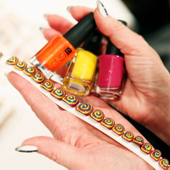 """The nail look featured a palette of four shades from CND (Anchor Blue,  Electric Orange, Bicycle Yellow, and Plumville), creating a  """"past-in-the-present-mood,"""" explained the brand's Wanda Ruiz."""