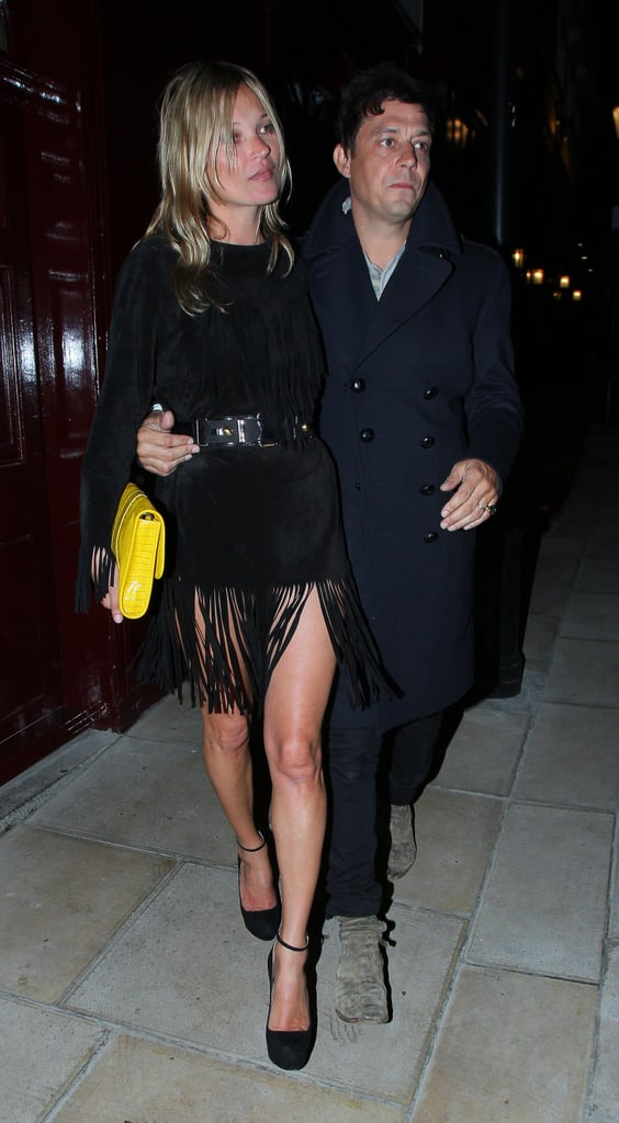 Kate Moss showed off her legs in a black fringed dress while out with Jamie Hince in London.