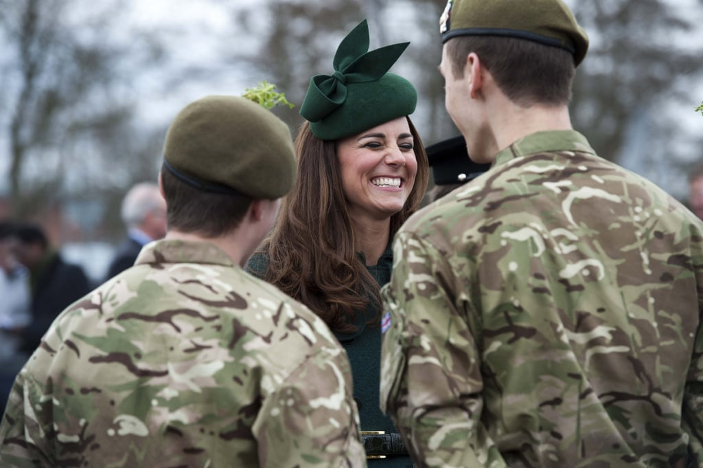 Kate Middleton had a good laugh as she participated in an annual St. Patrick's Day tradition of visiting the Irish Guards in Aldershot, England, on Monday.