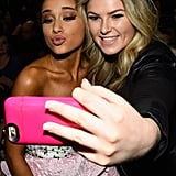 Ariana Grande Posing For Photos With a Fan