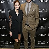 Olivia Palermo joined Johannes Huebl in olive accents at Stuart Weitzman's 5050 anniversary bash.