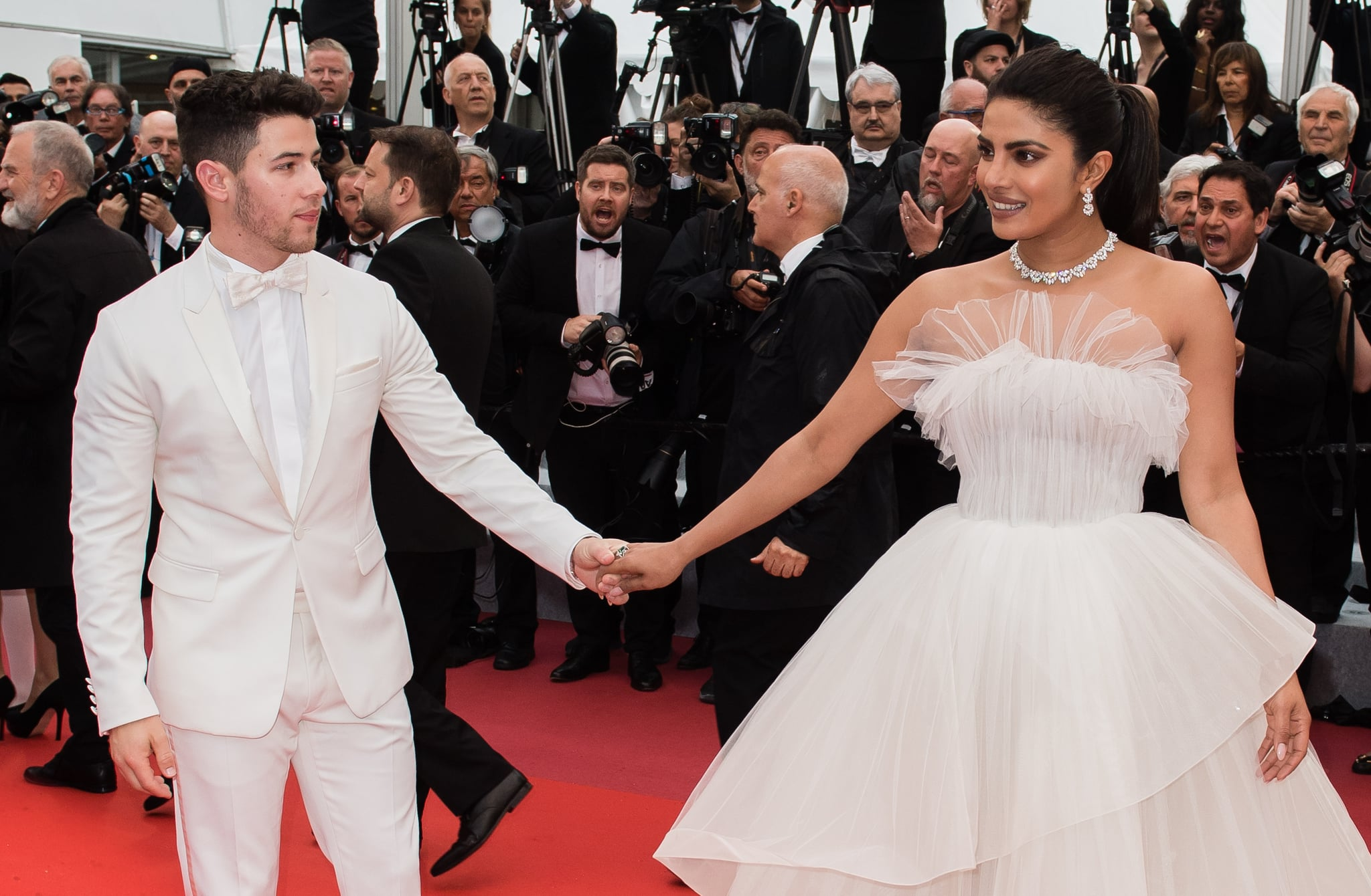 CANNES, FRANCE - MAY 18: Actress Priyanka Chopra and her husband Nick Jonas  attend the screening of