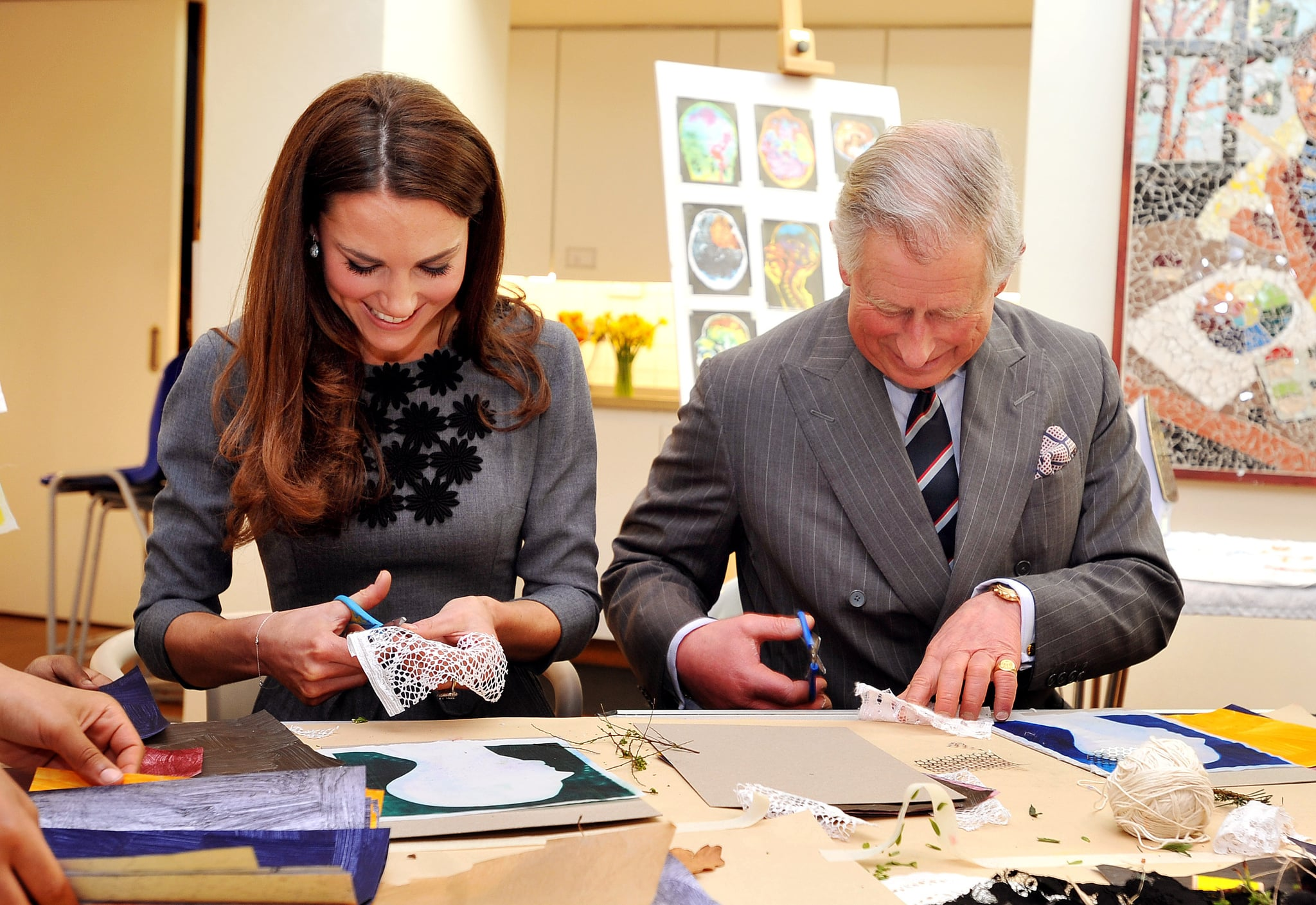 LONDON, UNITED KINGDOM - MARCH 15:  Catherine, Duchess of Cambridge and Prince Charles, Prince of Wales join children producing artwork during a visit to the Dulwich Picture Gallery on March 15, 2012 in London, England. The Duchess of Cambridge joined her parents-in-law Prince Charles, Prince of Wales and Camilla, Duchess of Cornwall on a royal visit to the gallery to celebrate their shared love of the arts and see work done by the Prince's Foundation for Children and the Arts. (Photo by Rota/Anwar Hussein Collection/Getty Images)