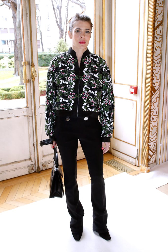Charlotte wore an embroidered bomber jacket and black pants to the Giambattista Valli show in March 2017.