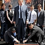Christian Bale, Anne Hathaway, Joseph Gordon-Levitt, and Elie Samaha proudly watched Christopher Nolan's hand and footprint ceremony in LA.