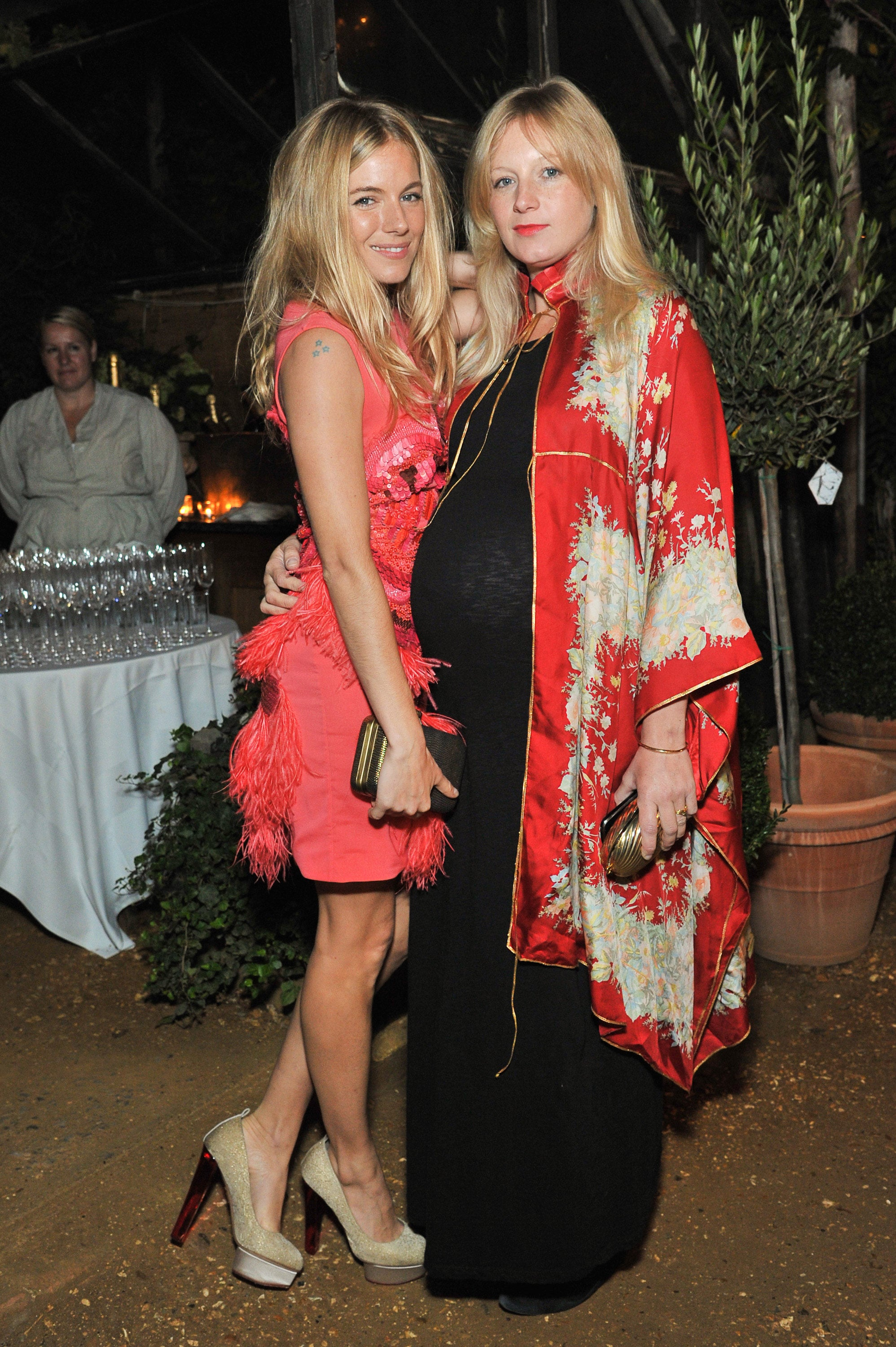 Sienna Miller and her pregnant sister Savannah out in England.