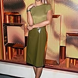 Laura wearing an olive green top with a patent leather skirt by Sies Marjan. She finished off her look with a Bulgari watch.
