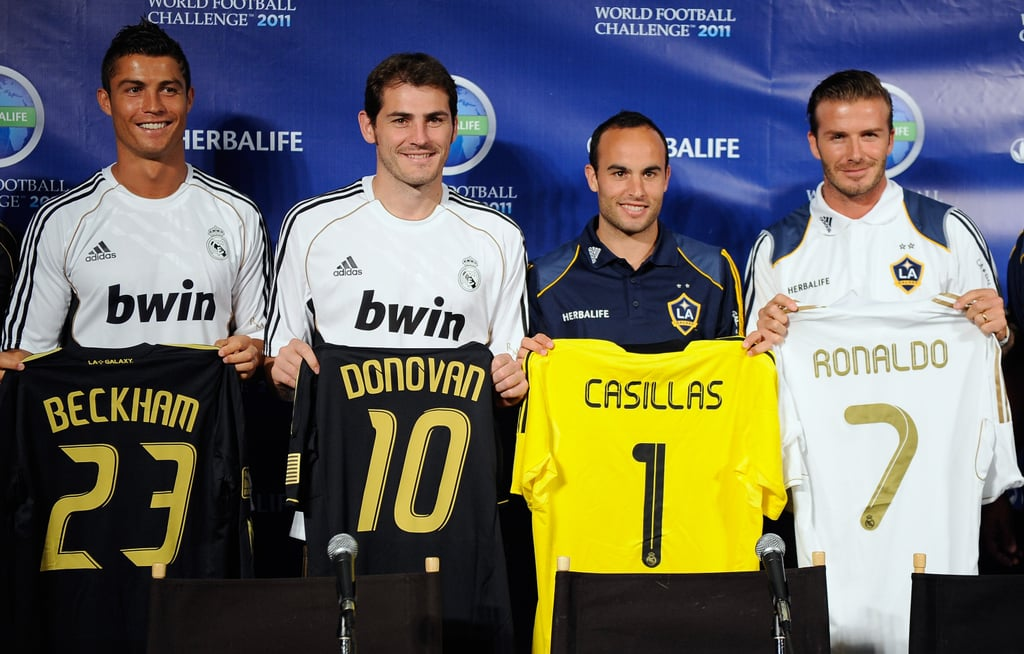 New dad David Beckham left Victoria and newborn Harper Seven Beckham for a few hours yesterday to join teammate Landon Donovan along with international opponents Iker Casillas and Cristiano Ronaldo at a press conference in LA. They foursome teamed up and switched jerseys coincidentally landing David with Cristiano's number seven, to announce the start of the Herbalife's World Football Challenge. The friendly soccer tournament kicks off tomorrow and continues through August 6. David's LA Galaxy is scheduled to compete against Cristiano's Real Madrid club on Saturday and though Victoria and baby Seven may miss out on the match, it's likely his boys Brooklyn, Cruz, and Romeo will take their usual seats in the stands to cheer on their all-star dad.