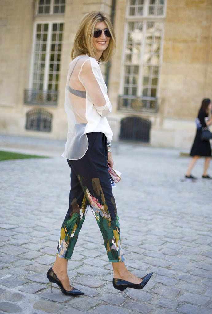 Sarah Rutson wore skinny painterly trousers and a sheer blouse with her black, skinny-heeled shoes. Source: Phil Oh