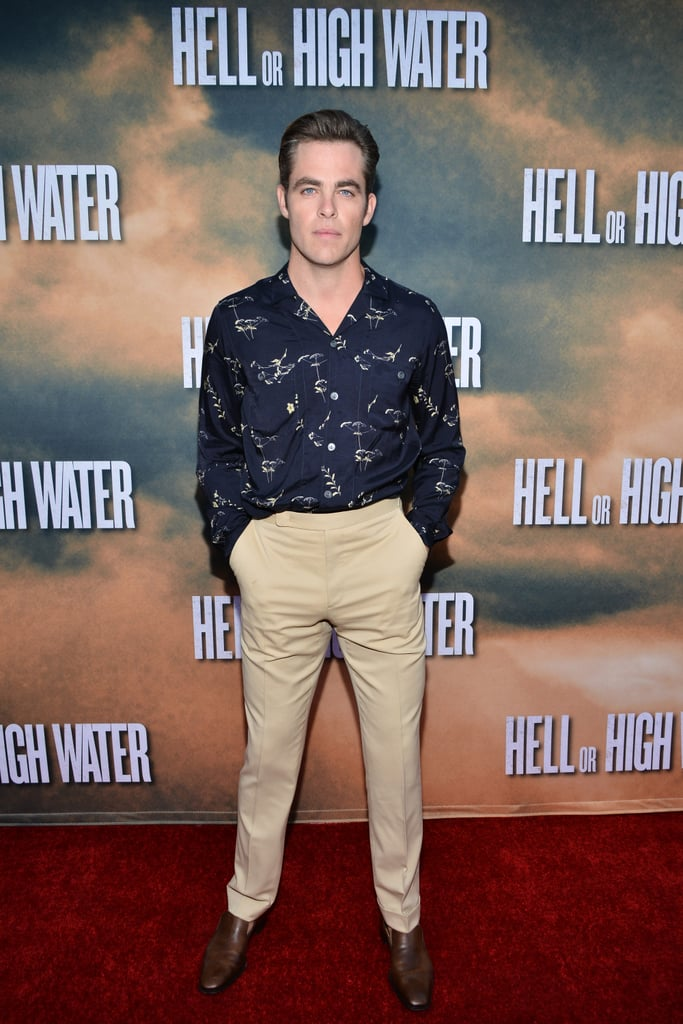 """Chris Pine rocked a retro look for the premiere of his new film, Hell or High Water, in LA on Wednesday. The actor sported a printed button-down shirt and high-waisted trousers, which he paired with brown dress shoes and his signature steely gaze. On the red carpet, Chris showed off his look while posing for photos and met up with his costar, Ben Foster, for a few snaps. In the film, Chris and Ben play brothers who attempt a series of bank heists to take care of their family. Of the action-thriller, Chris told Variety, """"It's about the failure of men to be intimate and vulnerable when they desperately want to be,"""" adding, """"But they just don't have the language or the facility to do so."""" Speaking of which, we are desperately hoping for a shirtless scene."""