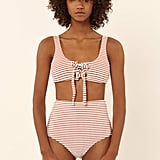 The noticeable texture of Mara Hoffman's Terry Lace-Up Front Tank Bikini Top ($155) brings volume to the area.