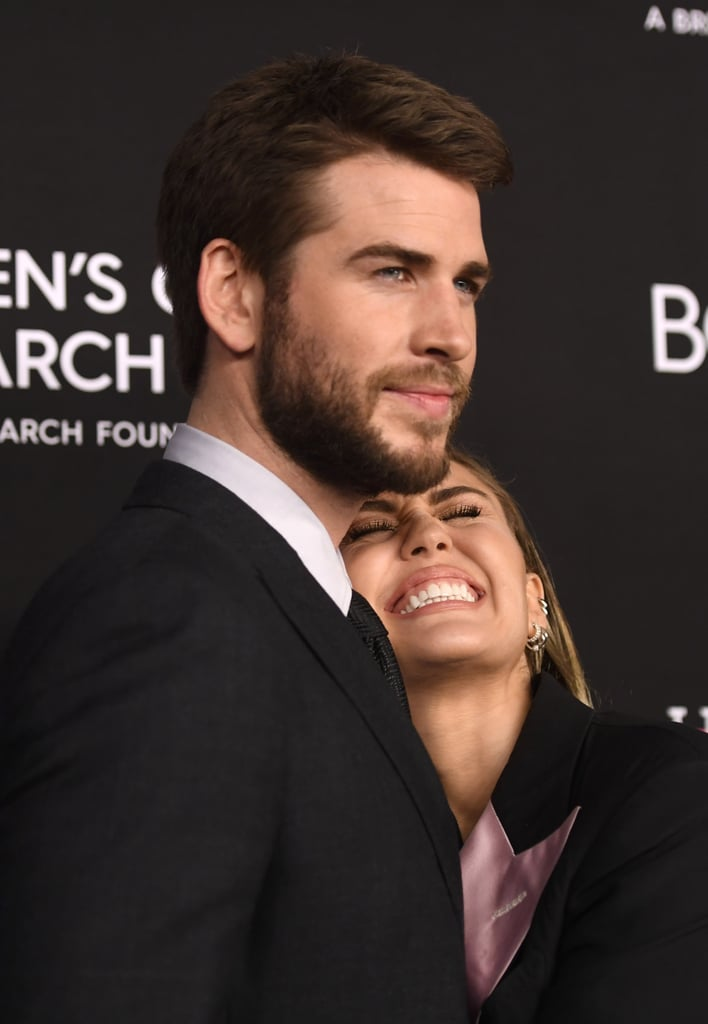 Miley and Liam cuddled up at the Women's Cancer Research Fund's Unforgettable Evening Gala in Feb. 2019.