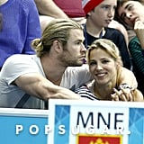 Chris Hemsworth had his arm around his wife at the Olympics.