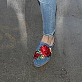 She Wore a Pair of Floral Embroidered Slides by Kenneth Cole
