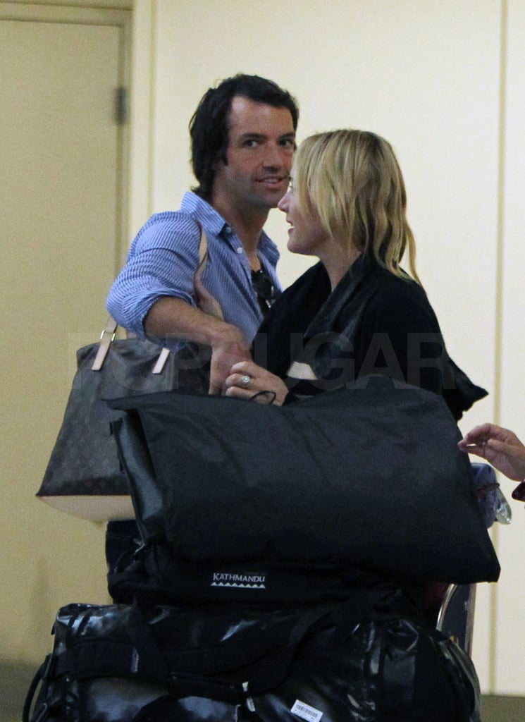 Nate carried Kate's bag for her.