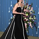Julia Roberts accepted the Best Actress award for her role in Erin Brockovich at the Oscars in 2001. She was wearing this now-famous Valentino gown with white piping, which became inspiration for her niece Emma Roberts later on.