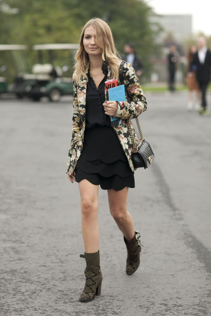 Feeling the floral on her jacket — and those studded boots, too.