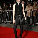 It Brit model Edie Campbell looked rock-chic in a leather skirt and black tights.