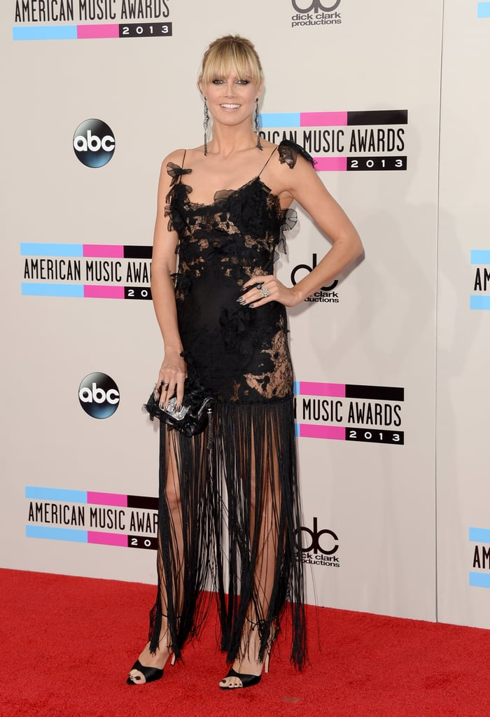 Heidi Klum's Marchesa dress mixed playful fringe with romantic cut-out flowers — and she carried both motifs through her whole look with Brian Atwood and Lorraine Schwartz accessories. Look hard at the accessories and you'll notice her dangling, fringed earrings and the blossoms covering her clutch.