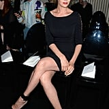 Uma Thurman took in Atelier Versace's couture show in all black. She put her long legs on display in a little black Versace dress and sexy ankle-strap pumps.