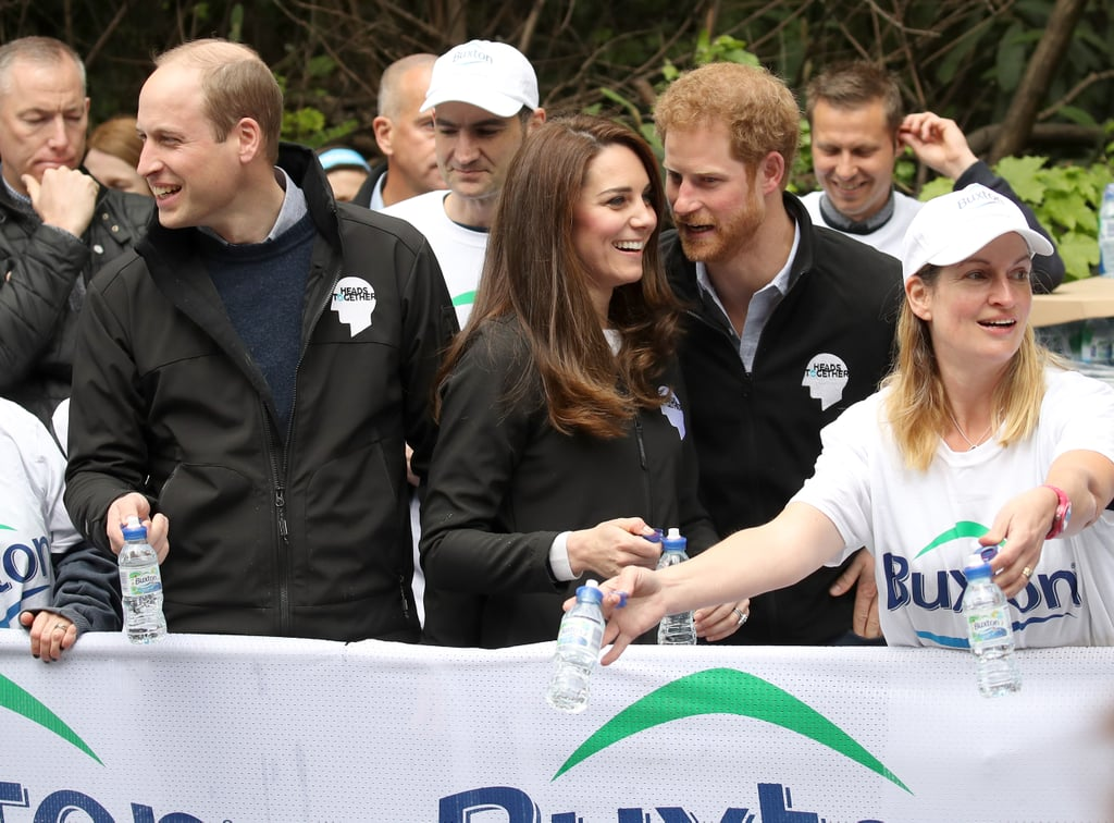 prince harry leaned in to chat with kate while they were handing out