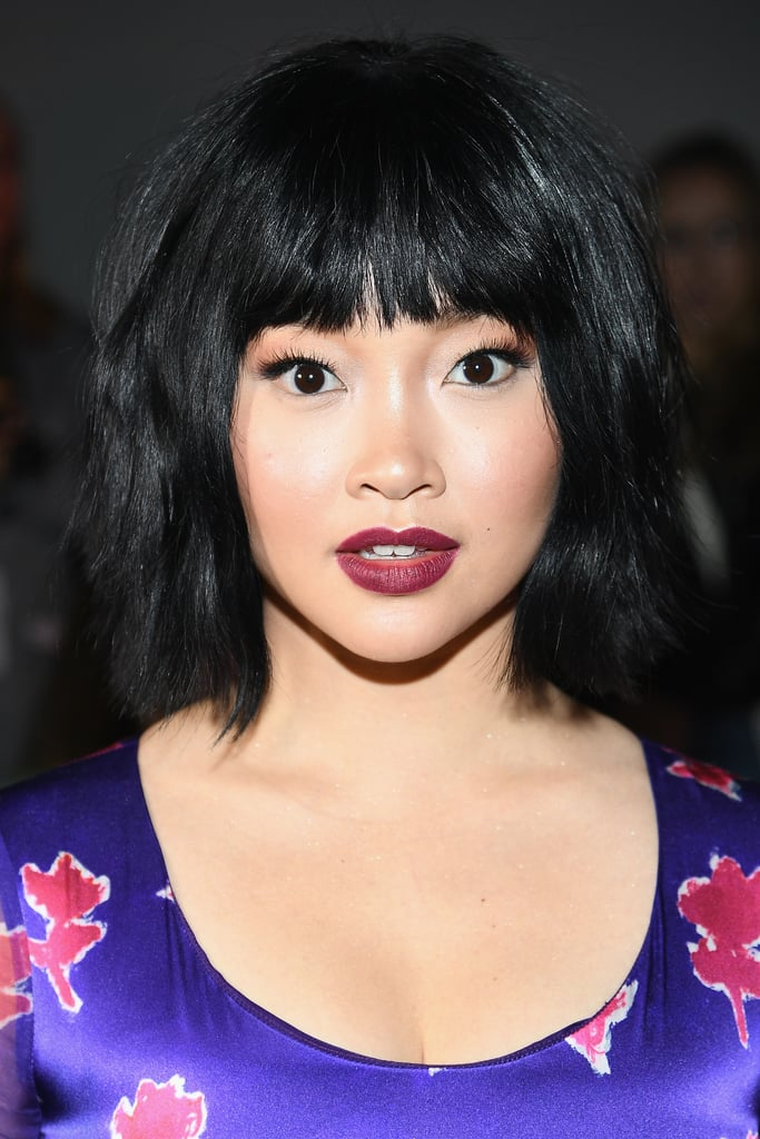 Lana Condor has been switching up her hair look lately, and we can barely keep up. First, she chopped it into a chic lob. Then she added some pops of electric purple for the premiere of Alita: Battle Angel. Now, her hairstylist Matt Fugate revealed that she cut bangs and layers into her chin-length hair. Condor is one of many celebrities taking the bangs plunge lately.  The actress joins Bella Hadid, Elizabeth Olsen, Constance Wu, and many other stars who've worn the style since the beginning of the year. Check out Condor's new bangs ahead, while you contemplate getting your own.      Related:                                                                                                           Everyone Wore Bangs to the Critics' Choice Awards, So Call Your Stylist ASAP