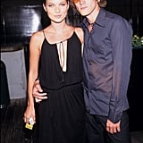 At a magazine launch party with Anthony Langdon in 1999, wearing a jersey dress with cowl front.