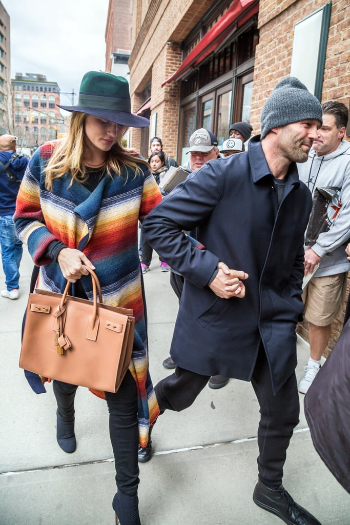 Rosie paired a colour block fedora with a striped coatigan and Saint Laurent bag.