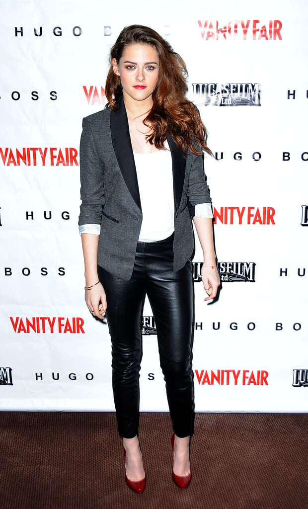 Kristen went for a cool leather look for a screening of On the Road in December. She styled up a pair slick faux-leather H&M pants, a slouchy white tee, and BCBG Max Azria blazer with red Christian Louboutin heels.