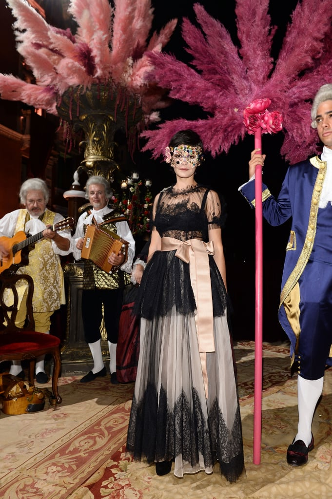 At the Dolce & Gabbana masquerade ball, Audrey Tautou was a dream in her black-and-pink lace confection.