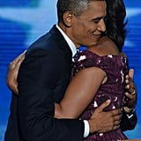 Barack smiled as he hugged Michelle during the DNC.