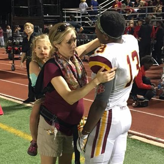 Pregnant Doctor Straps Her Kid on Her Back For Football Game