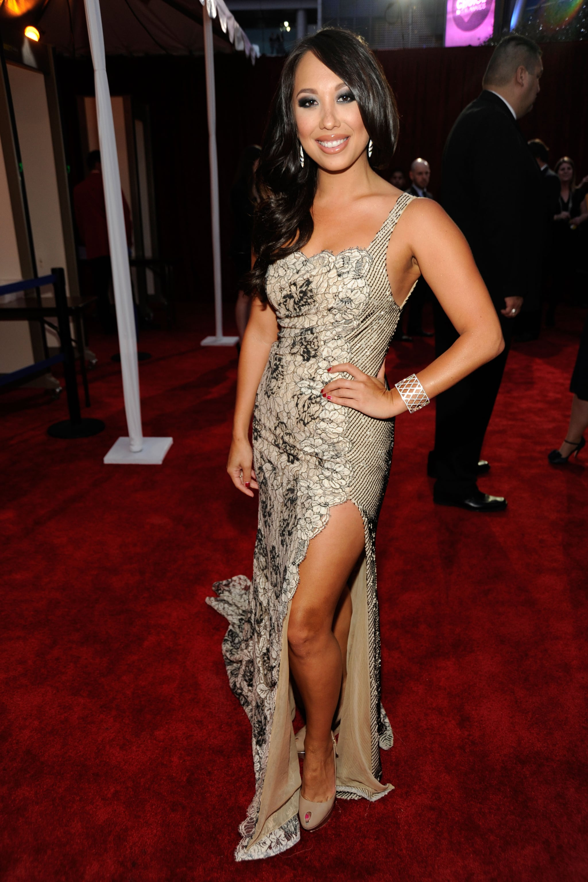 Cheryl Burke in a slitted gown.
