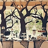 A little black lace and some tree silhouettes help make for a graceful tabletop. These trees strike a delicate balance between being a little spooky while still remaining classy.