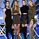 Gigi took a break from the runway to hang out with the supermodels at the Sports Illustrated Swim City event. She posed alongside Lily Aldridge, Hannah Davis, and Nina Agdal and wore a black leather miniskirt by The Kooples, a turtleneck sweater from Blaq, and her suede over-the-knee Stuart Weitzman boots.