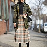 Ladylike plaid and a bit of camo are the proof that opposites do attract.  Source: Le 21ème | Adam Katz Sinding