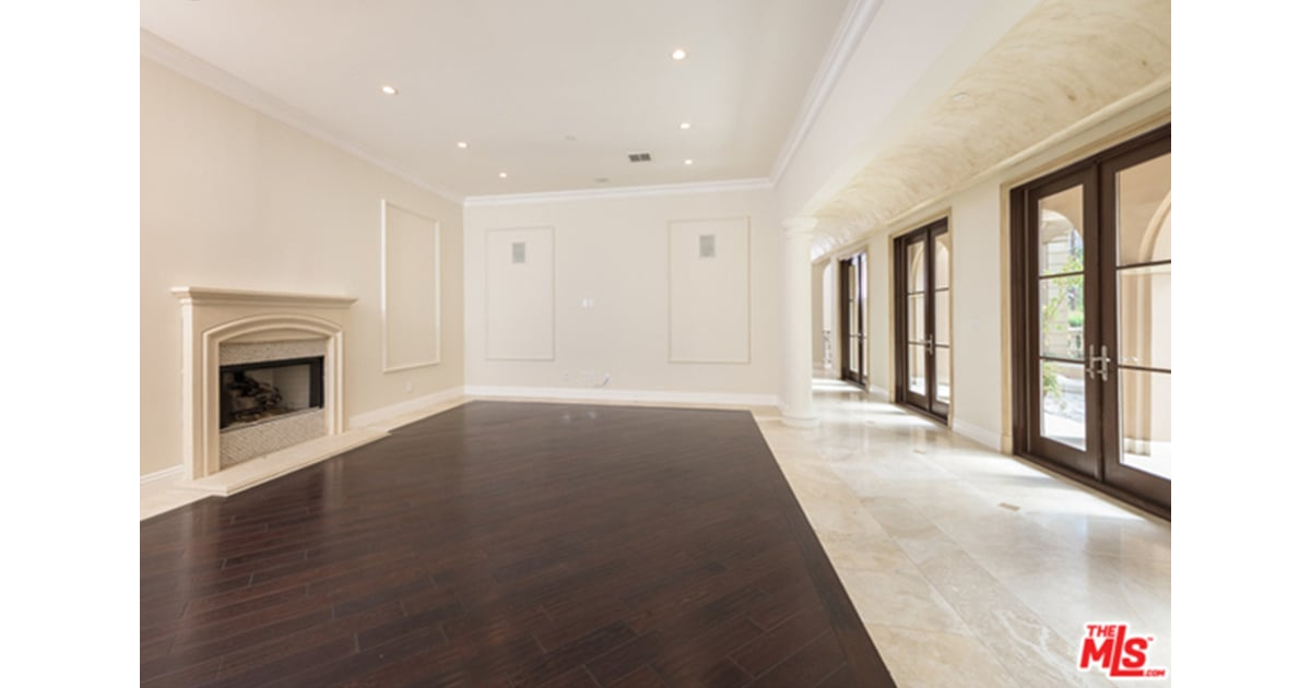 The Half Wood Half Marble Floors In The Living Room Make