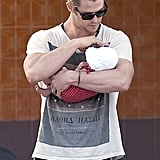 Chris Hemsworth cradled baby India in his arms in Madrid.