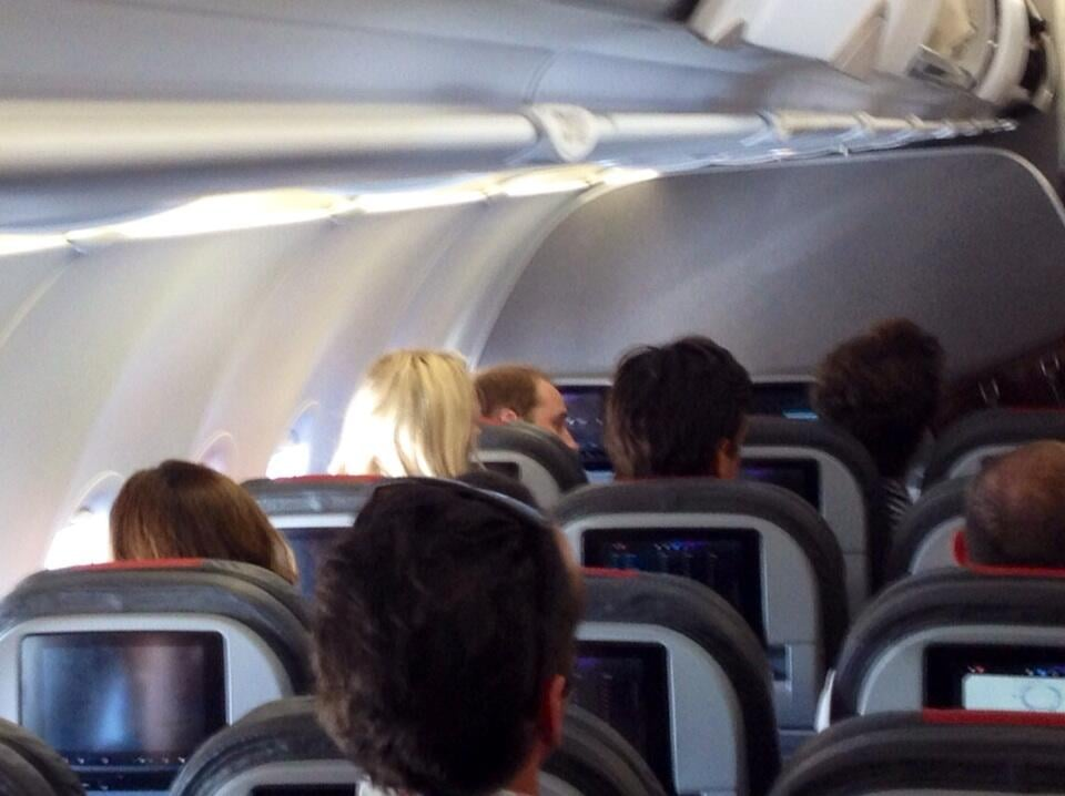 William sat in coach on an American Airlines flight on Sunday. Source: Twitter user local24eli