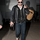 Rob wore a hat and sunglasses upon arrival.