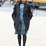 A sweet printed dress got a boyish twist with loafers and a newsboy cap.