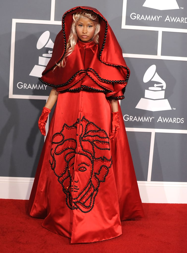 Nicki Minaj made a serious statement on the Grammys red carpet in a red hooded cape and matching ball skirt.