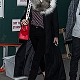 Gigi stepped out in a look that felt slightly '70s inspired after the DVF show. She wore a top printed with graphic hearts — for Valentine's Day — black skinny jeans, red zipper-front boots, a luxe coat, and a furry scarf. Gigi accessorized with round KREWE du optic printed sunglasses and a Fendi bag.
