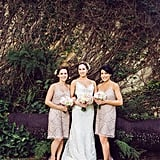 These two bridesmaids wore knee-length, patterned blush dresses.