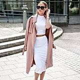 A White Matching Set and Rose-Colored Trench