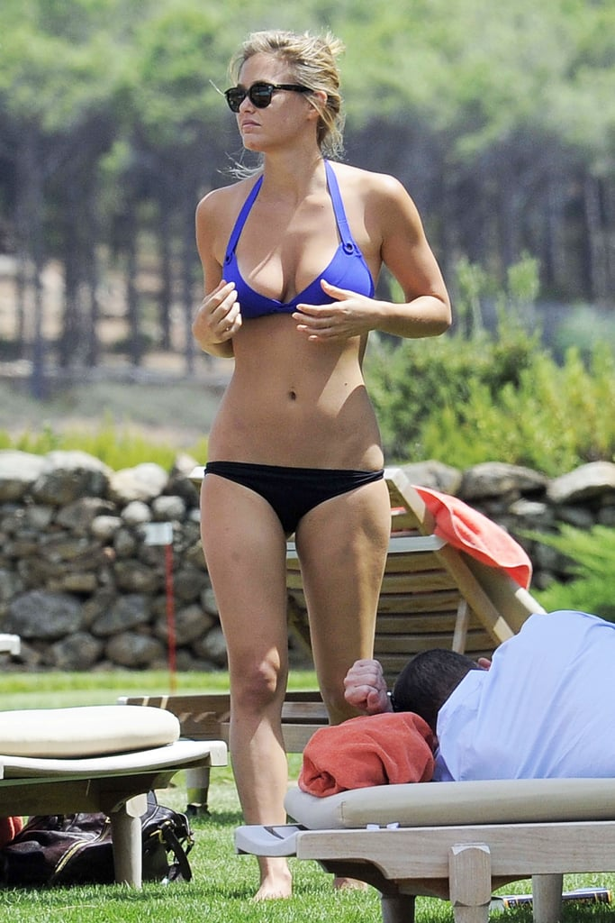 Bar Refaeli personalized her bikini yesterday mixing a purple top with one of her tried and true tiny black bottoms in Italy yesterday. The supermodel's continuing her romantic vacation with boyfriend David Fisher, and the pair moved their relaxation from the coast inland to the hotel Cala di Volpe located in Porto Cervo, Italy. Bar and David cuddled in the shade and played with their iPad before changing and heading to dinner. Bar joined her friend Vale Micchetti for dinner in Sardinia, which included a hearty steak and a plate full of fruity desserts. Don't forget you can vote for Bar, Miranda Kerr, Gisele Bundchen, and other famous figures in PopSugar's Bikini Bracket — fill out your bracket for a chance to win $1,000 from J.Crew!