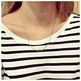 We love Steph's fine gold necklace, especially toughened up with this striped Sportsgirl tee!