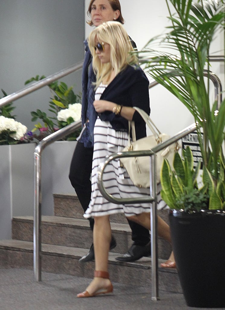 Reese Witherspoon covered her growing baby bump in a flowing dress yesterday while out in LA. The expecting mom is a few months along with her first child with husband Jim Toth. Reese and Jim married in March 2011. She's also a proud mother to two children from her previous marriage to Ryan Phillippe, 12-year-old Ava Phillippe and 8-year-old Deacon Phillippe.  It was back to LA for Reese after attending last Saturday's White House Correspondents' Dinner in Washington DC. Reese is keeping her political connections in tact despite a return to California. She even offered to host a political fundraiser at her LA home. The president's reelection committee, though, decided to host an Obama event at George Clooney's home instead, since it's a better fit.