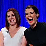 Cobie Smulders let out a big laugh and leaned into How I Met Your Mother costar Alyson Hannigan.