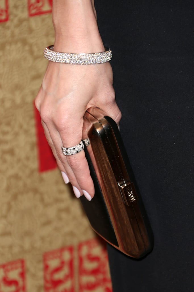 Just look at all those diamonds — Allison Williams added a Cartier pavé bracelet and ring to her ensemble, then finished with a mirrored clutch in hand.